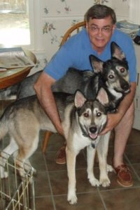 """Our Cousin, Mike Higgs, with our his two """"puppies"""" Teddy and Mercy"""