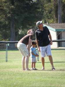 Chris, Little Chris and Randy flying a kite